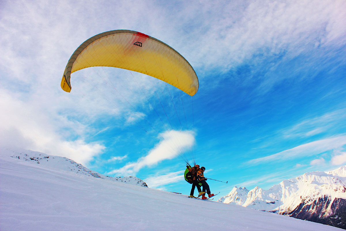 paragliding over the ski slopes in bormio